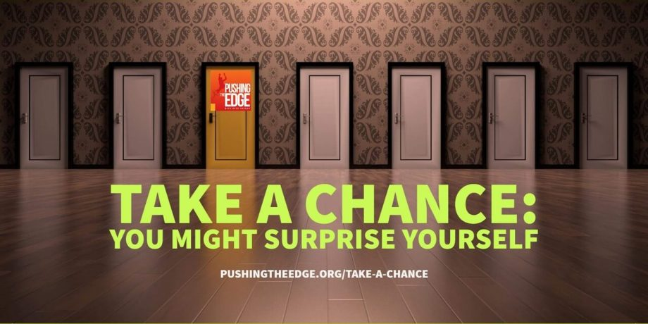 Text - Take a chance you might surprise yourself. Backdrop row of doors with one door being a different colour